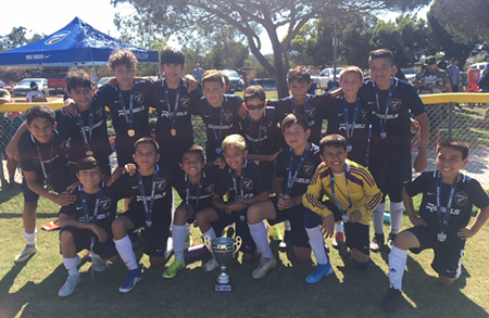 B2007 Premier White posing after wining the Surf Summer Classic Tournament 2019